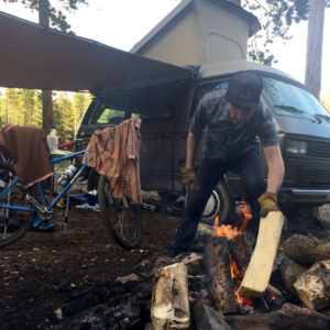 Putting log on the fire